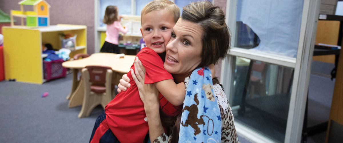 Jennifer Cunningham, Garden City's assistant city manager, drops off her son Brodie at day care.