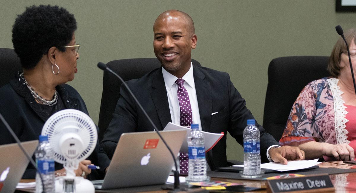 Dr. Charles Foust, the Kansas City, Kansas, USD 500 superintendent, speaks to school board president Maxine Drew.