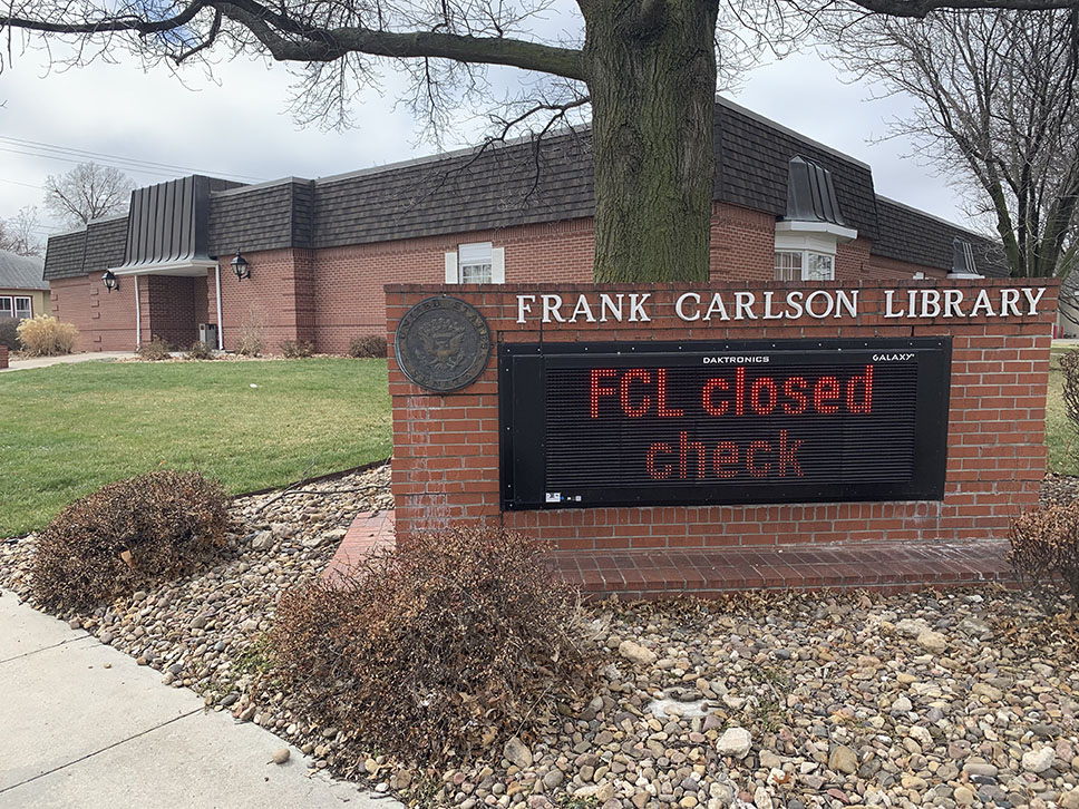 A closed sign in front of Concordia's library.