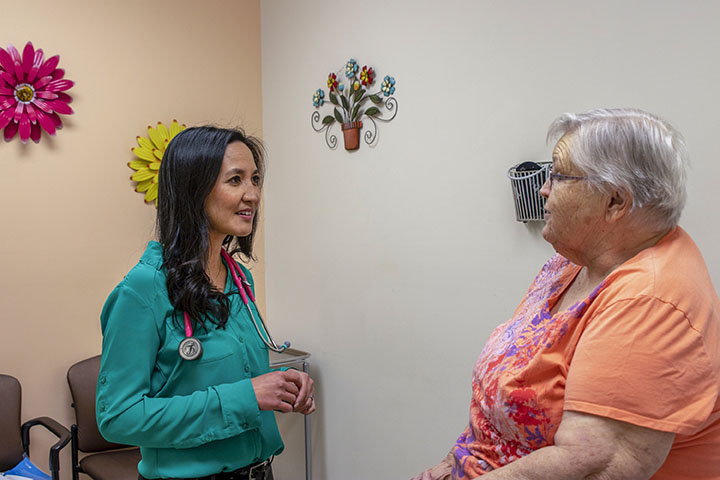 Rural health physician meets with patient