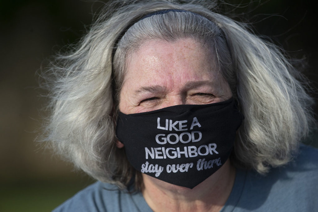 A new dividing line in Kansas is developing around people who wear masks in public and those who don't