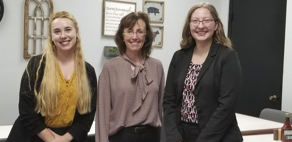 Etta Walker, center, is vaccinated and takes COVID protocols seriously at her law practice. She is hosting a farewell celebration for her summer interns, Emma Hochman, left, and Stephany Rother.