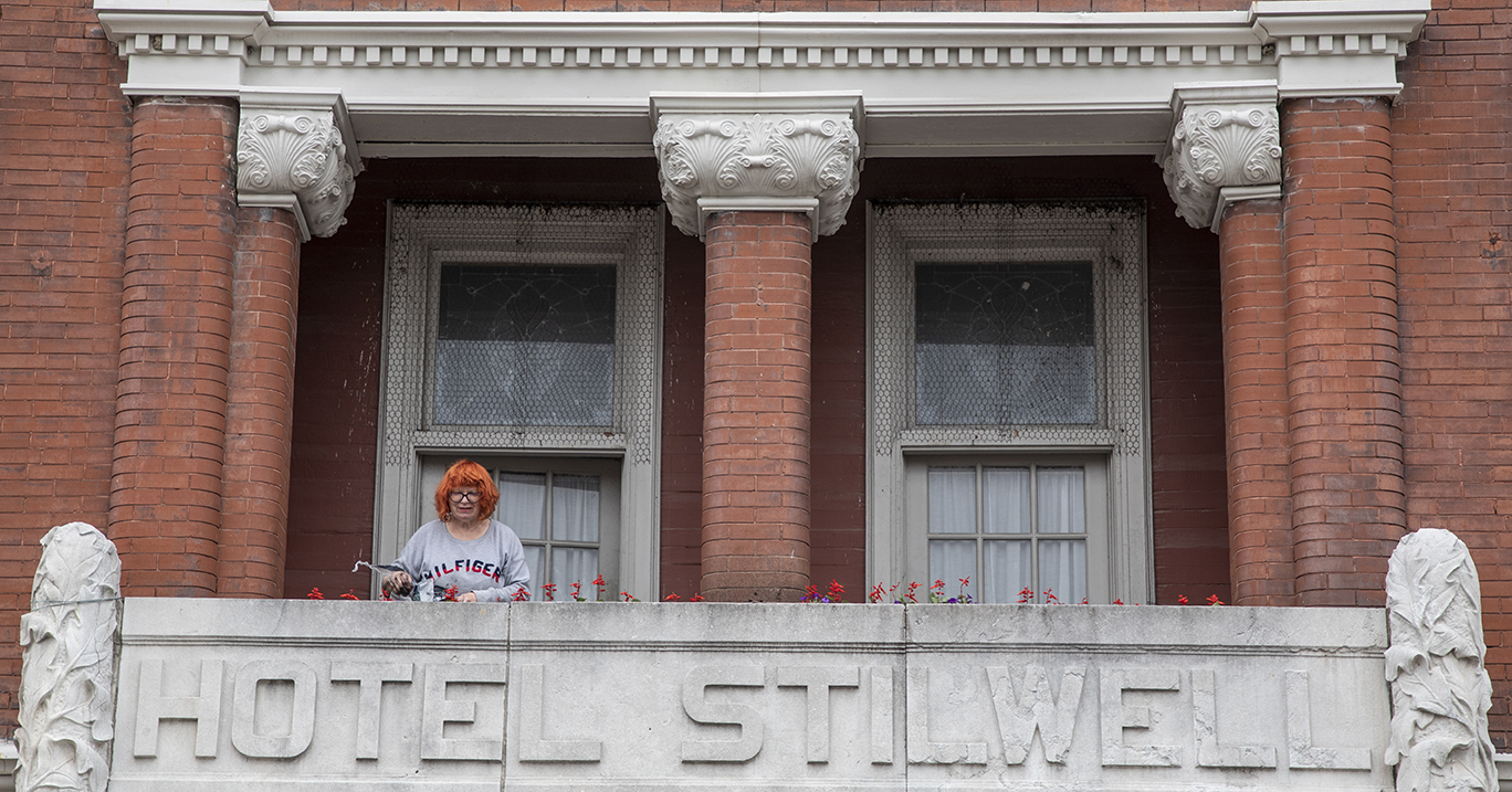 Darlene Brown, manager of the Hotel Stilwell, waters flowers