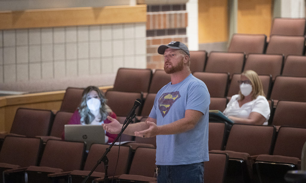 Wellington parent Josh Coomey speaks during a school board meeting last month
